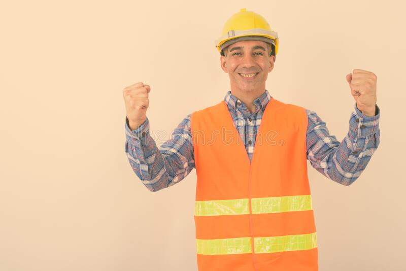 Portrait of mature Persian man construction worker royalty free stock images