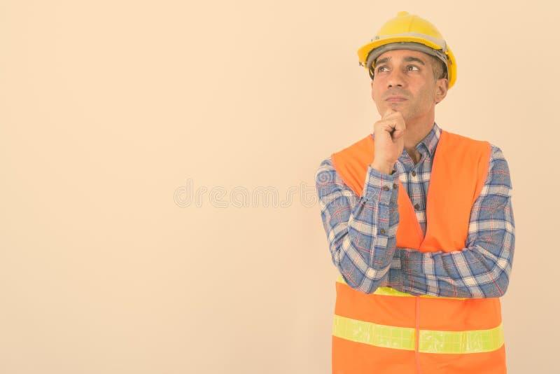 Portrait of mature Persian man construction worker stock photo