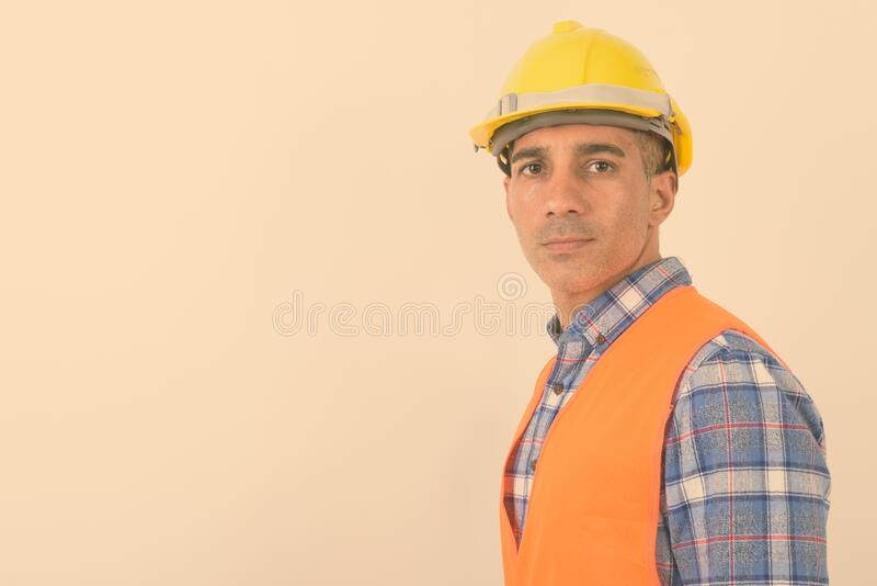 Portrait of mature Persian man construction worker stock images