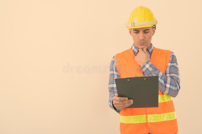 Portrait of mature Persian man construction worker royalty free stock image