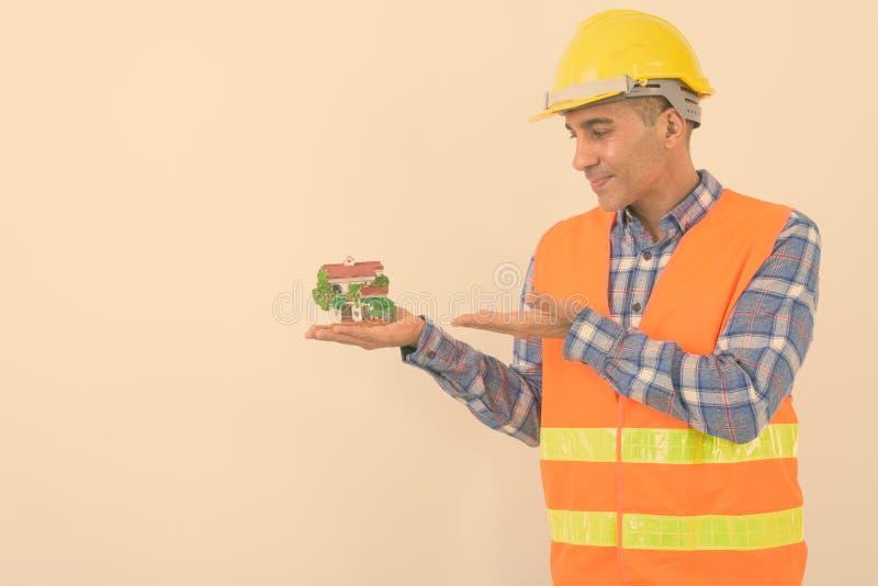 Portrait of mature Persian man construction worker stock photos