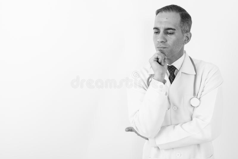 Mature Persian man doctor in black and white stock photos