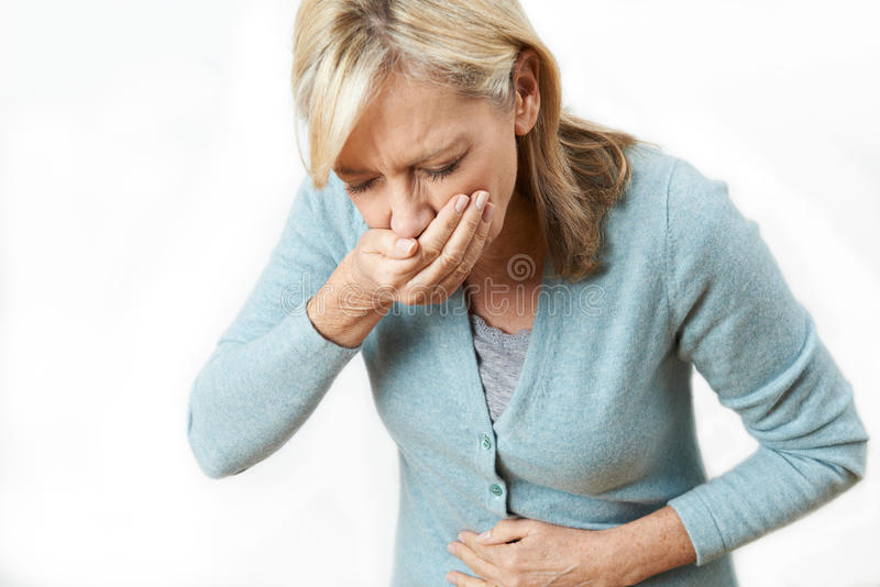 Studio Shot Of Mature Woman Suffering From Nausea stock images