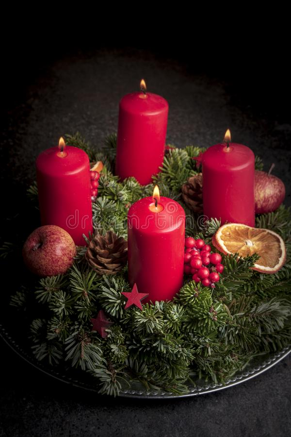 Studio shot of a nice advent wreath. And four burning red candles royalty free stock images