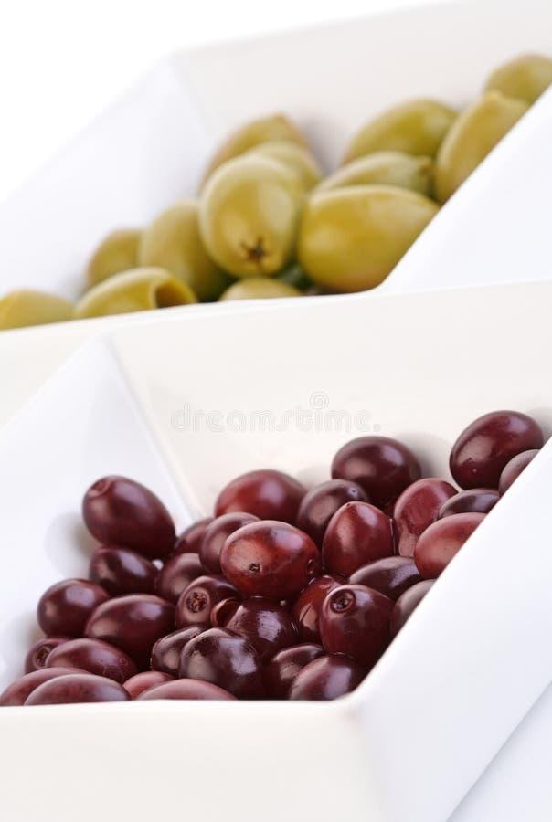 Studio shot of olives in bowl stock image