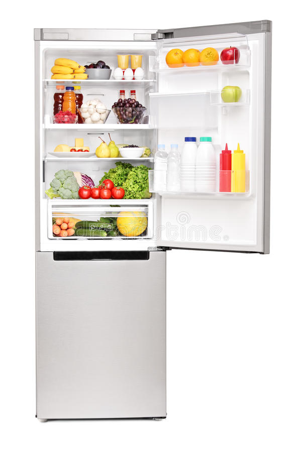 Studio shot of an open fridge full of healthy food products lizenzfreies stockfoto