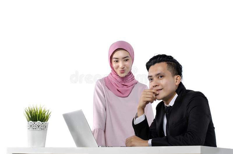 Young couple entrepreneurs discussing ideas with a laptop in front of them royalty free stock photo