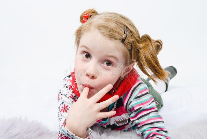Studio shot of pretty little girl royalty free stock photo
