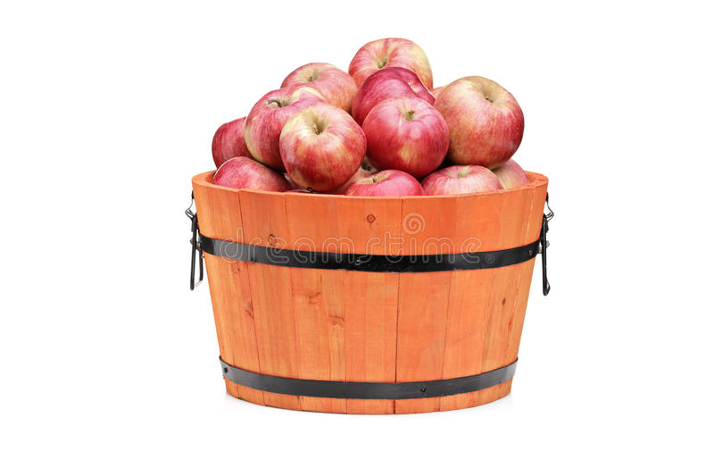 Studio shot of red apples in a wooden barrel stock images