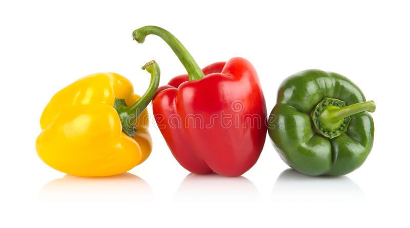 Studio shot of red,yellow,green bell peppers isolated on white. Studio shot of red,yellow,green bell peppers in line isolated on white background stock image