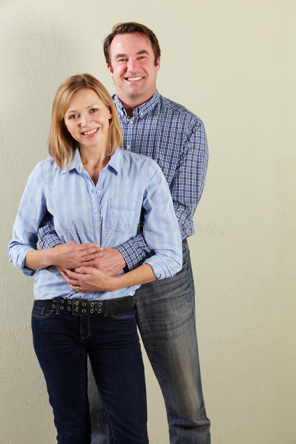 Studio Shot Of Relaxed Middle Aged Couple royalty free stock image