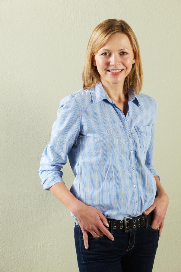 Download Studio Shot Of Relaxed Middle Aged Woman Stock Photo - Image: 23959896