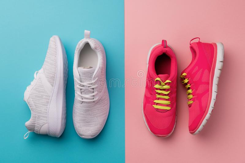 A studio shot of running shoes on bright color background. Flat lay. royalty free stock images