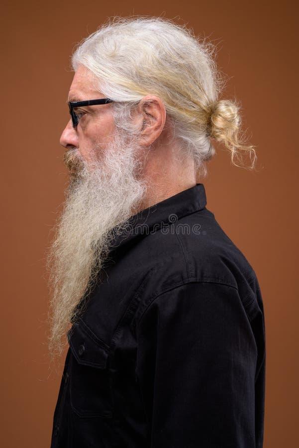 Portrait of senior bearded man profile view while thinking stock photos