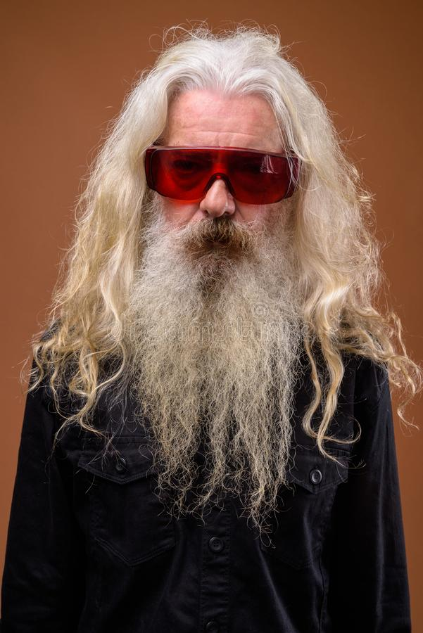 Portrait of senior bearded man wearing red glasses royalty free stock photos