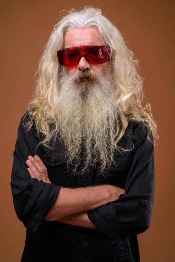 Portrait of senior bearded man wearing red glasses stock images