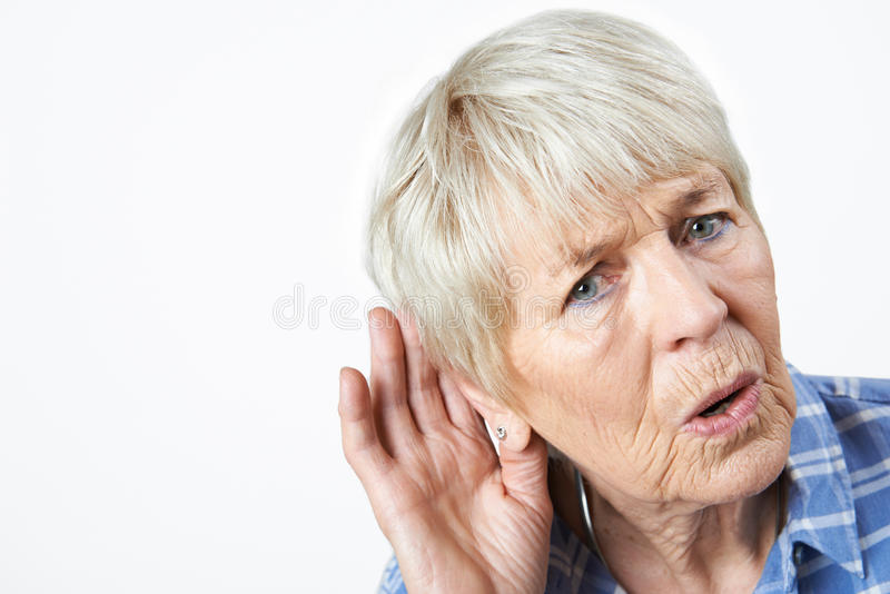 Studio Shot Of Senior Woman Suffering From Deafness royalty free stock photography