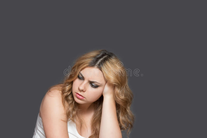 Studio shot of serious attractive long haired teenage girl stock photography