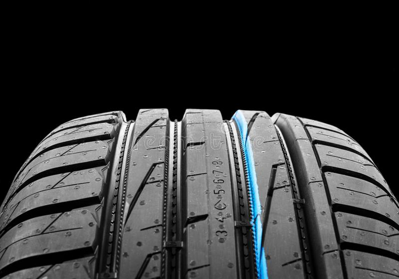 Car tire isolated on black background. Tire stack. Car tyre protector close up. Black rubber tire. Brand new car tires. Close up b royalty free stock photos