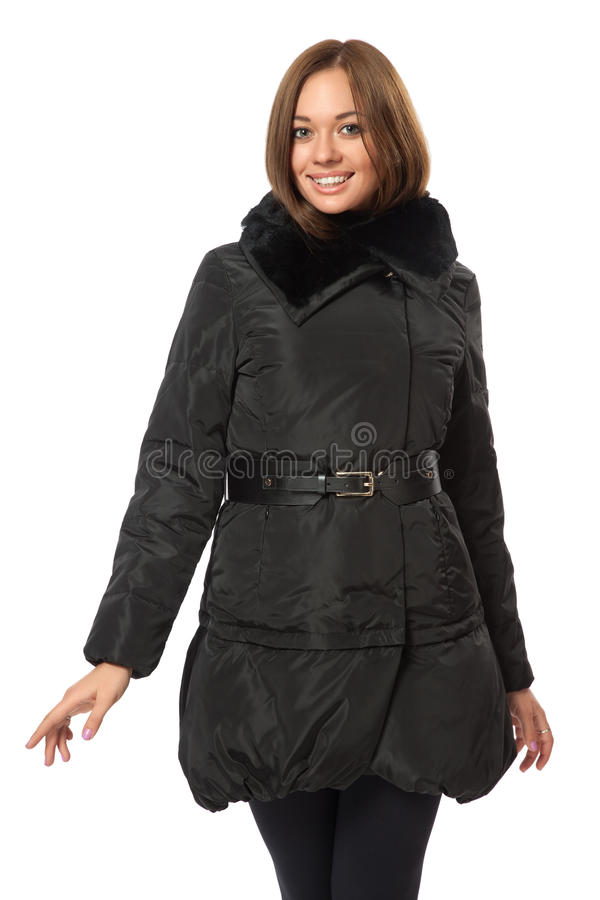 Girl in a black downy coat stock images