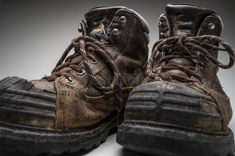 Studio shot of sreel toed hiking boots. Pair of steel toed hiking boots on a grey studio background stock photography