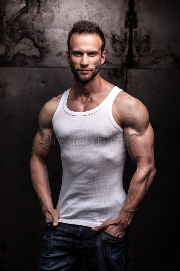 Strong athletic man on dark grunge background royalty free stock photos