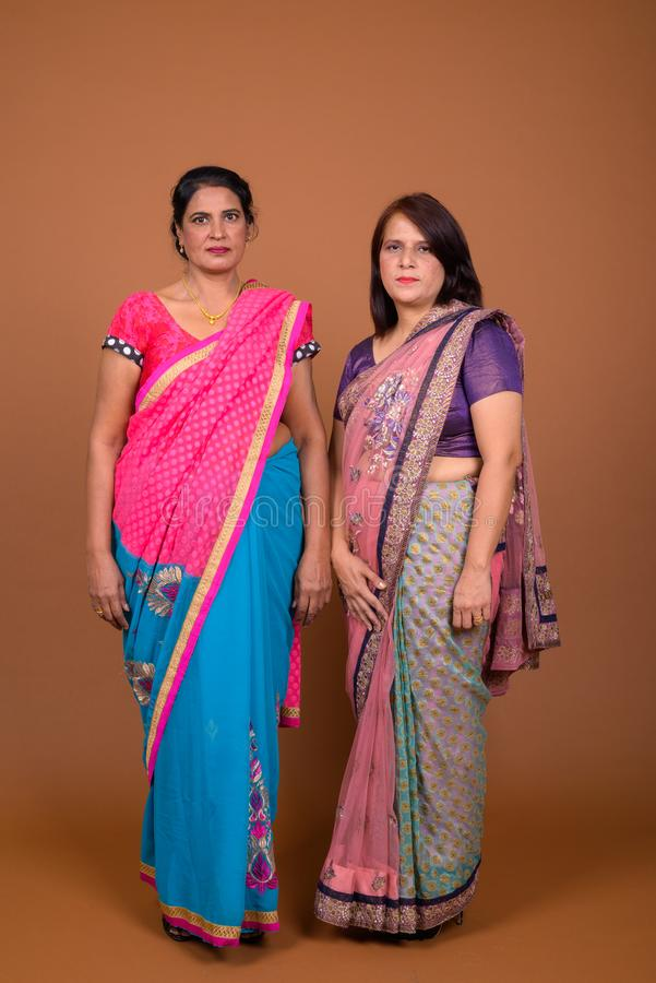 Two mature Indian women wearing Sari Indian traditional clothes stock image