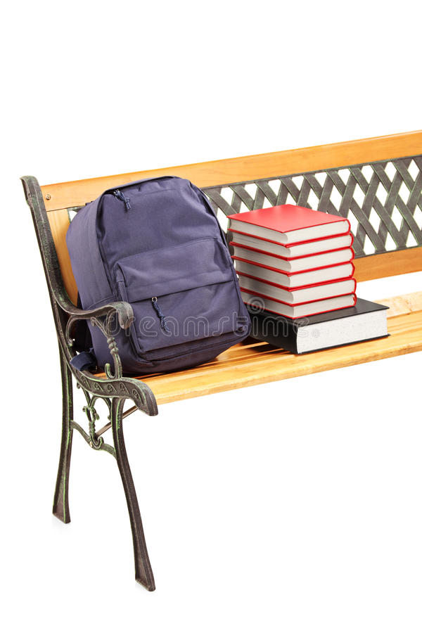 Studio Shot Of A Wooden Bench With Books And School Bag On It Stock Photo