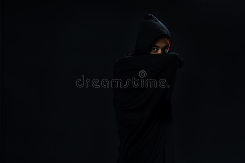 Studio shot young Asian boy in black cover cosplay to dracula ho royalty free stock images
