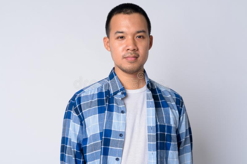Portrait of young Asian hipster man with short hair stock photography