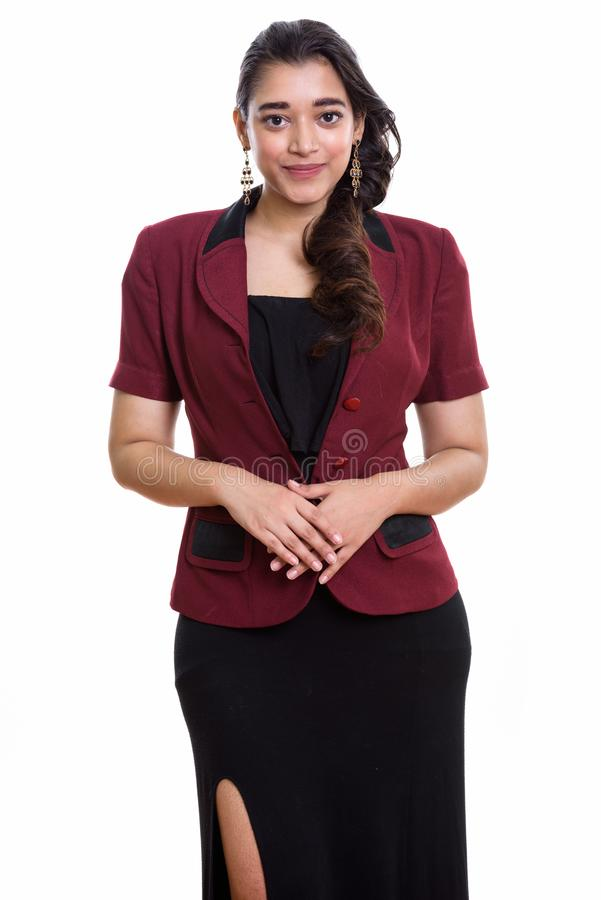 Studio shot of young beautiful Indian businesswoman standing wit royalty free stock images