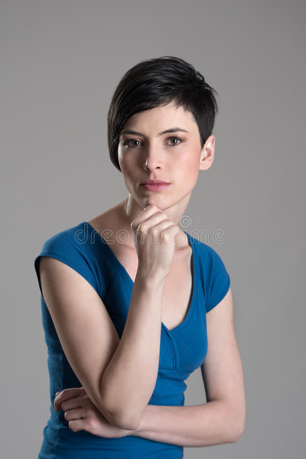 Studio shot of young beautiful short hair woman thinking stock photo