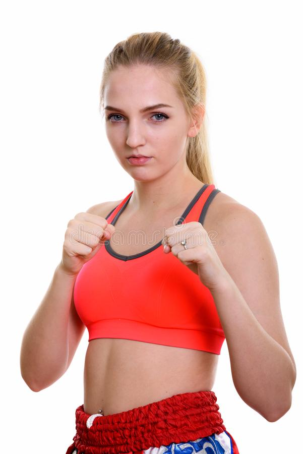 Studio shot of young beautiful teenage girl muay thai fighter re. Ady to fight stock photos