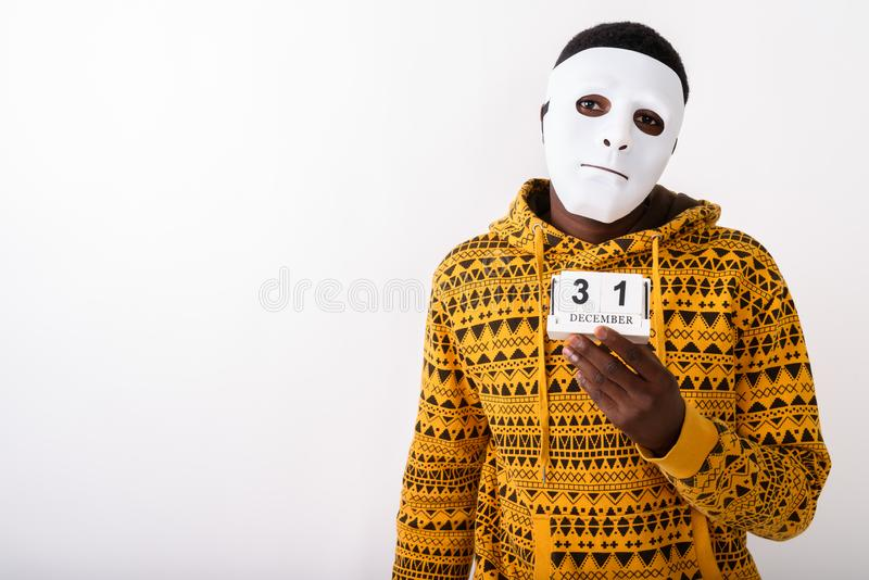 Studio shot of young black African man wearing white mask while royalty free stock photos