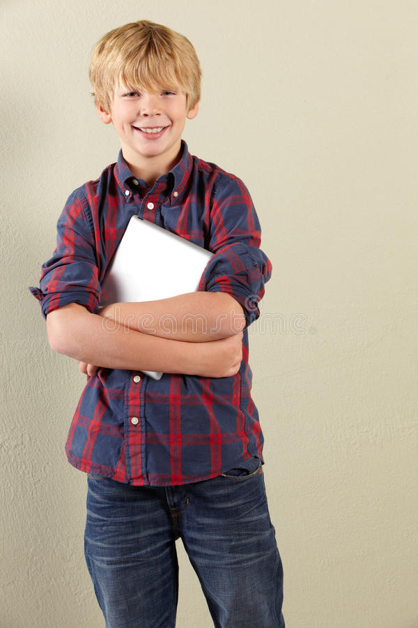 Download Studio Shot Of Young Boy Holding Tablet Computer Stock Image - Image: 23960211