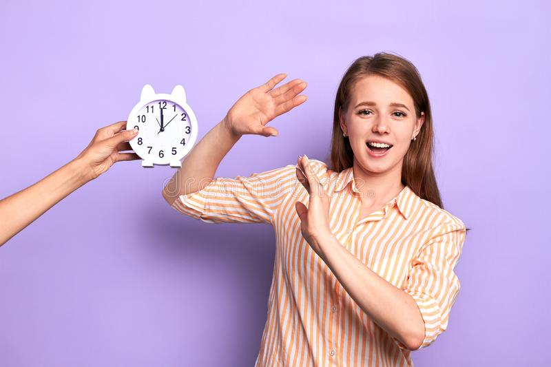 Female employee refuses to stay extra hours at work, deadline and pressure concept. Studio shot of young female employee refuses to stay extra hours at work royalty free stock images