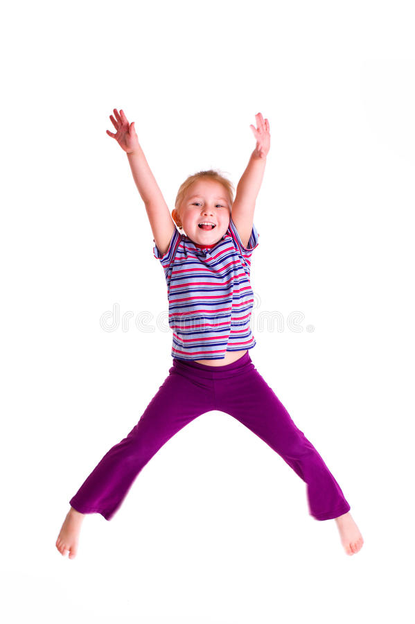 Studio shot of young girl jumping stock images