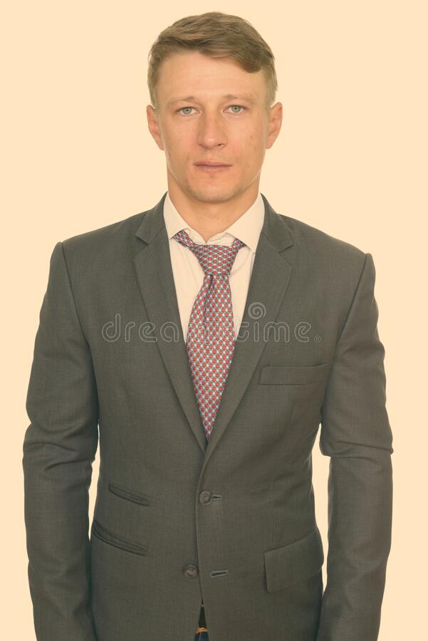 Studio shot of young handsome Caucasian businessman isolated against white background stock photography