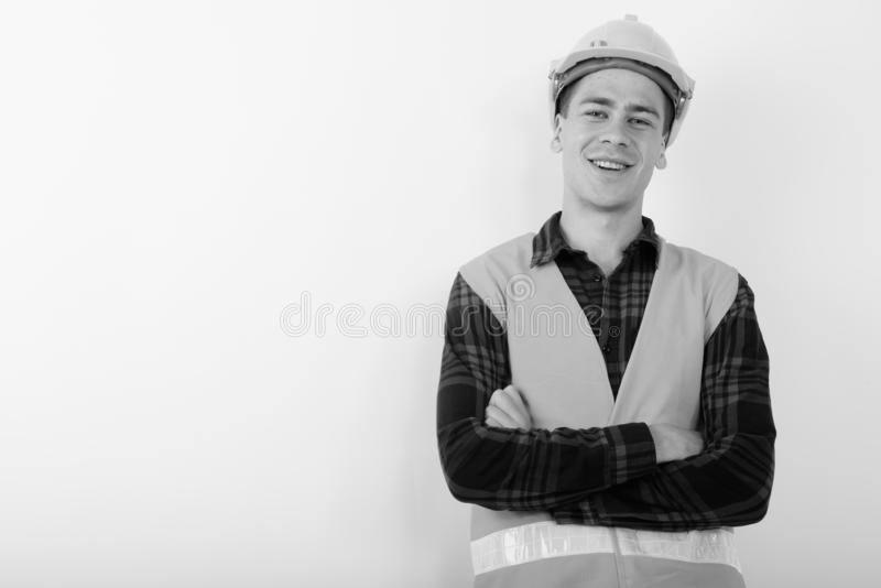 Portrait of young handsome man construction worker in black and white stock images