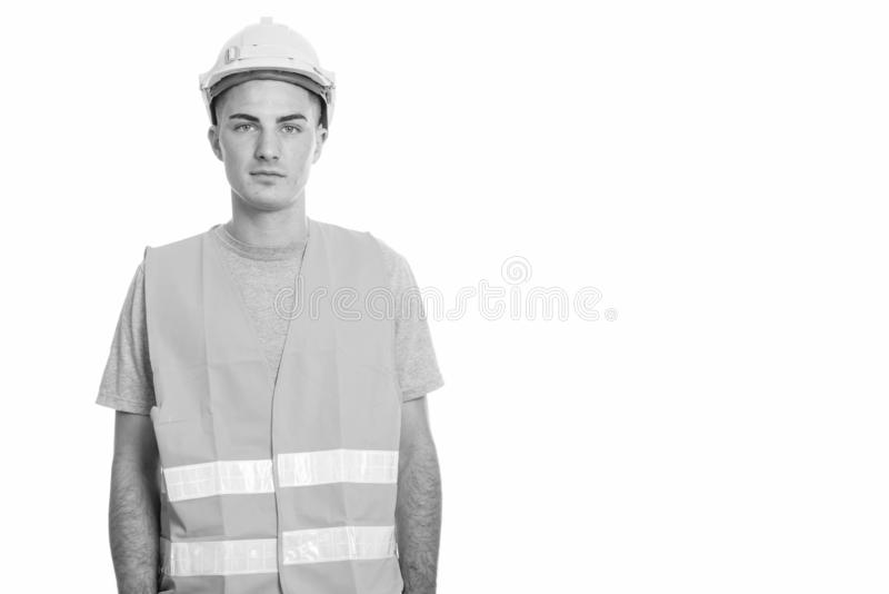 Studio shot of young handsome man construction worker royalty free stock photo