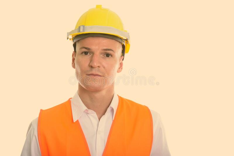 Studio shot of young handsome man construction worker royalty free stock photography