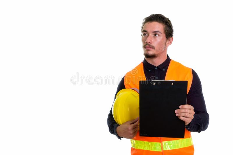 Studio shot of young handsome man construction worker thinking w stock photos
