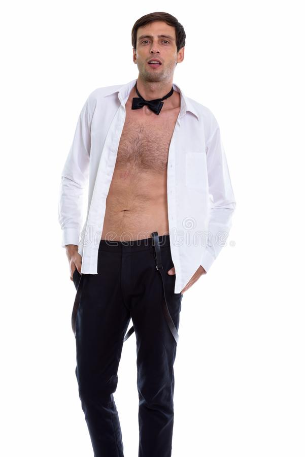 Studio shot of young handsome man posing with open shirt while w stock photography