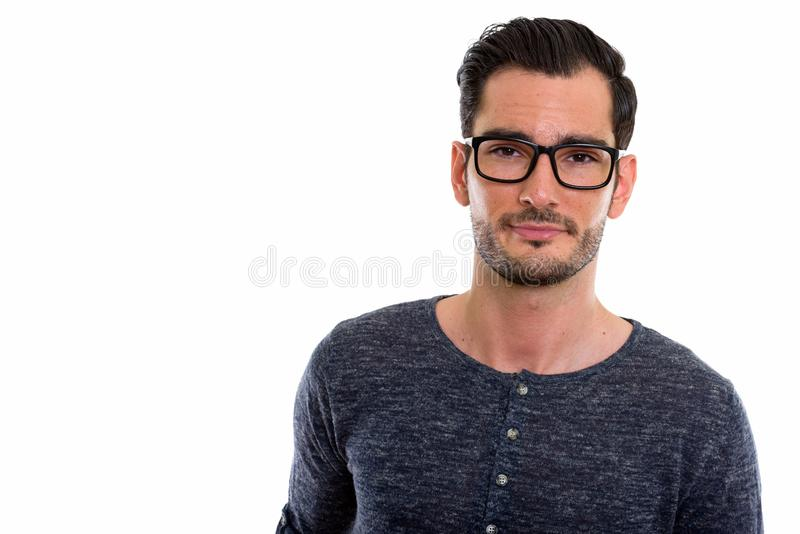 Studio shot of young handsome man wearing eyeglasses royalty free stock photography