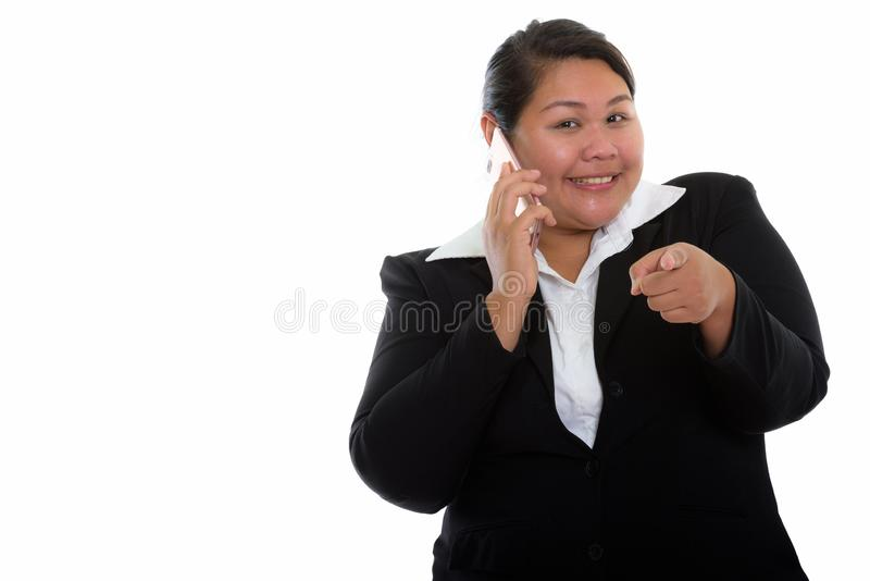 Studio shot of young happy fat Asian businesswoman smiling while royalty free stock photos