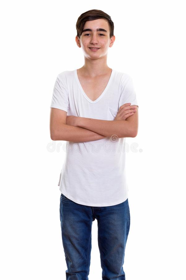 Studio shot of young happy Persian teenage boy smiling and stand royalty free stock photos