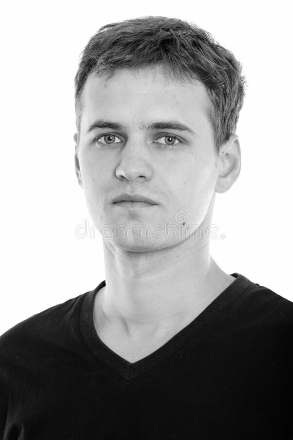 Studio shot of face of young man stock image