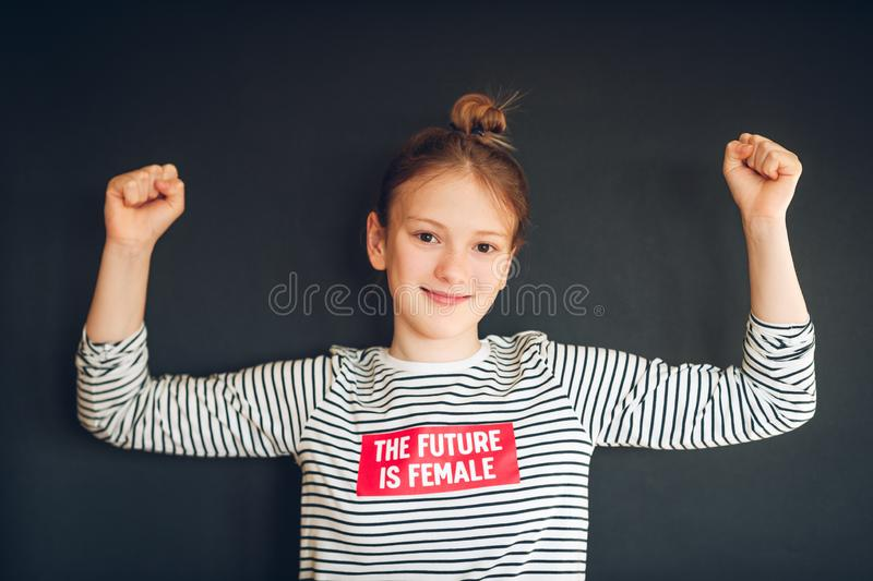 Studio shot of young strong preteen girl stock images