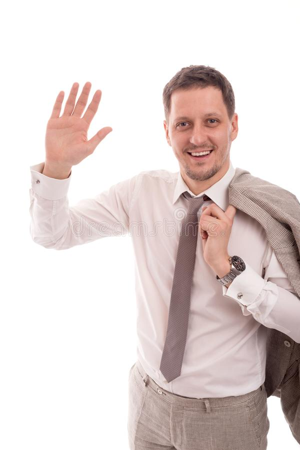Studio shot of a young successful businessman wearing beige suit with hand welcoming , isolated stock images