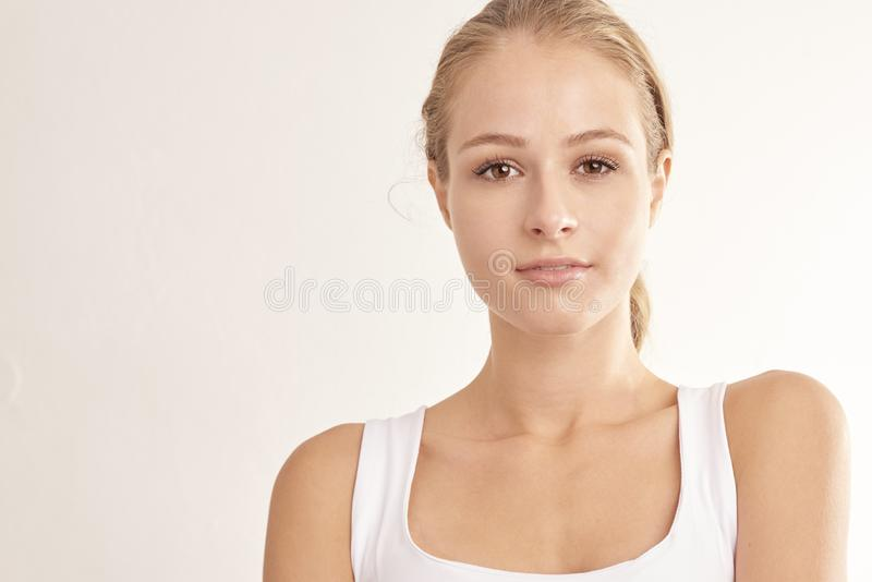 Studio shot of young woman with beautiful face royalty free stock photos